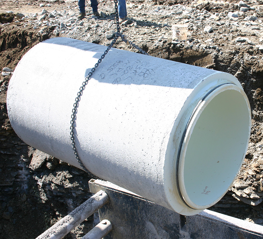 O-ring gasketed pipe being lowered into the trench