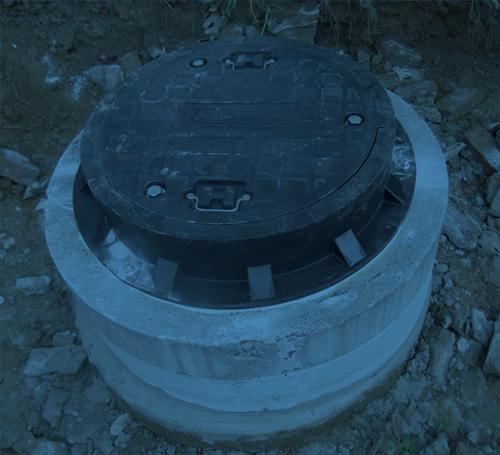 A watertight manhole system